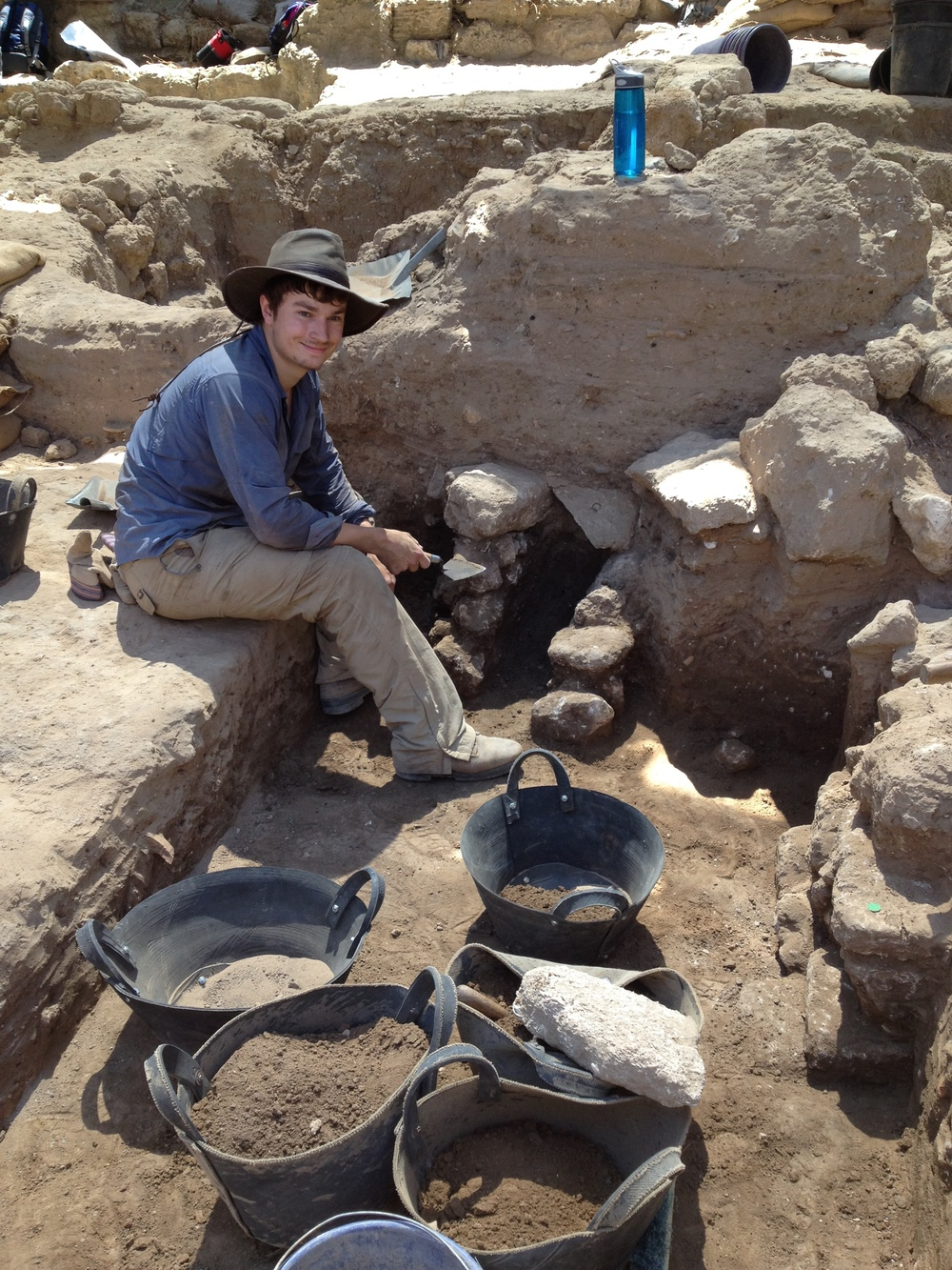 Chris sitting alongside a Phase 7 (5th c.) drain in Grid 51