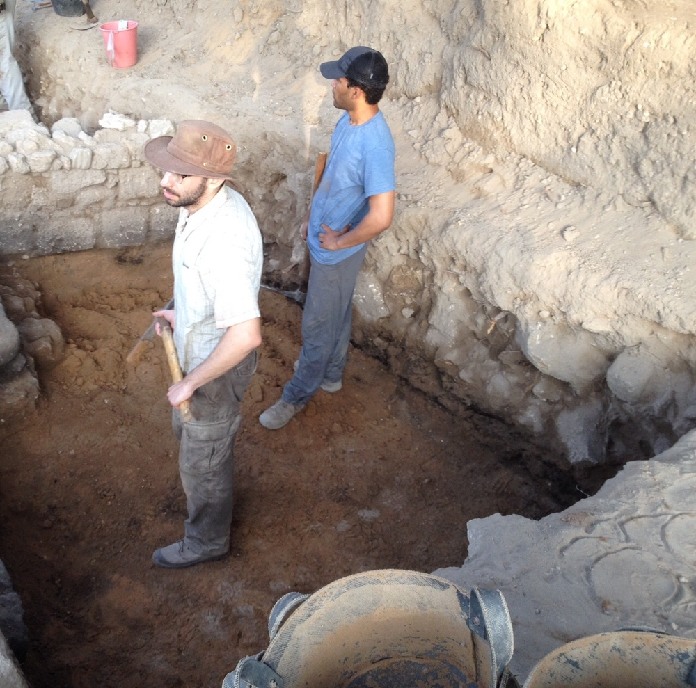 Excavating sand constructional fill under Islamic period walls