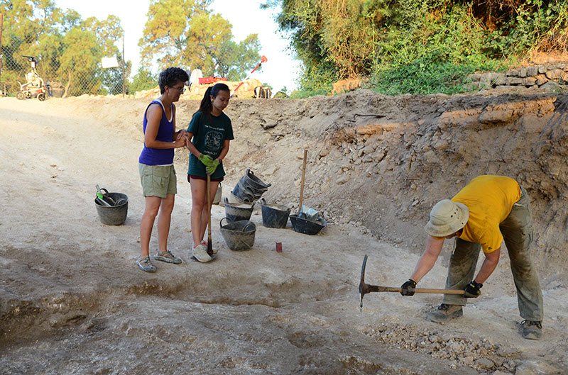 Ethan excavates a plaster subfloor in Grid 47