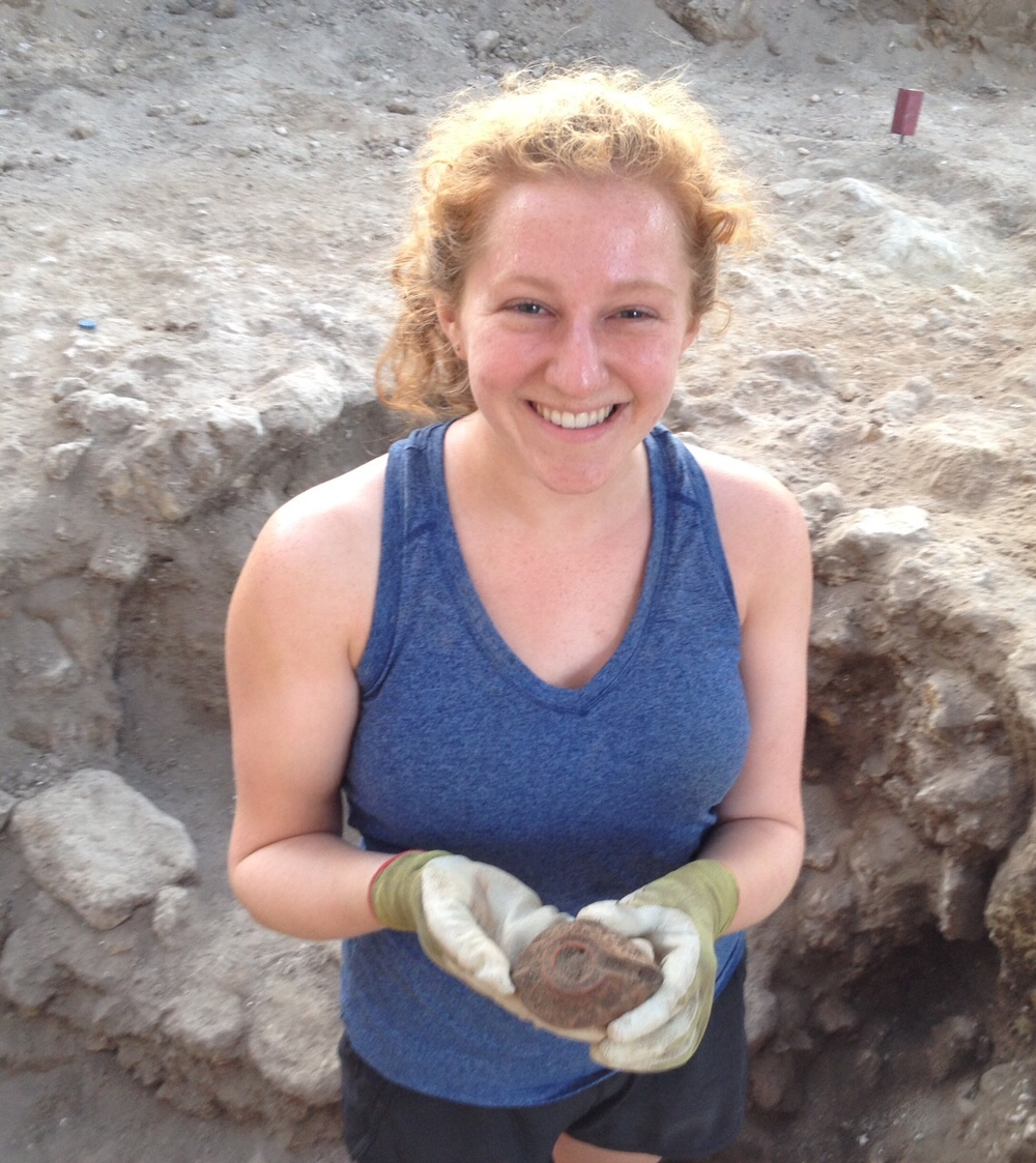 Miranda and the oil lamp she found while excavating a sewer