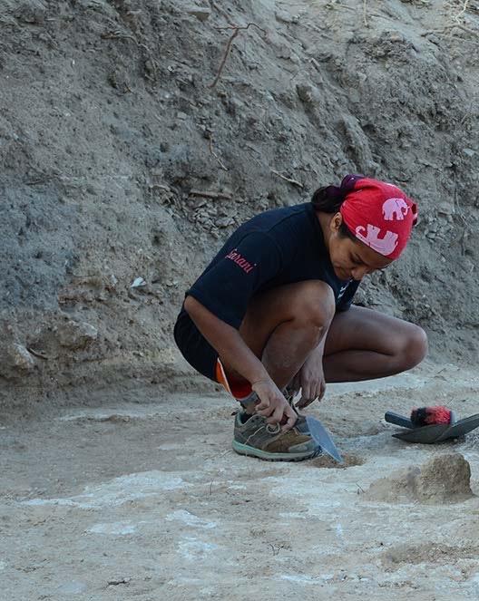 Sarani excavates a posthole