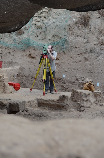 Ben, a member of the GIS team, working with the total station
