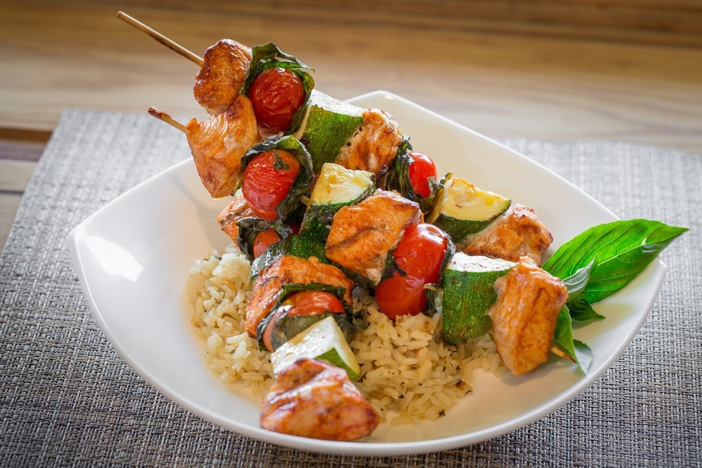 Italian Chicken Kabobs with Rice Pilaf | Kabob Skewers Loaded with Sundried Tomato-Rubbed Chicken Breast, Basil-Wrapped Tomatoes, and Chopped Zucchini. Served Over Rice.