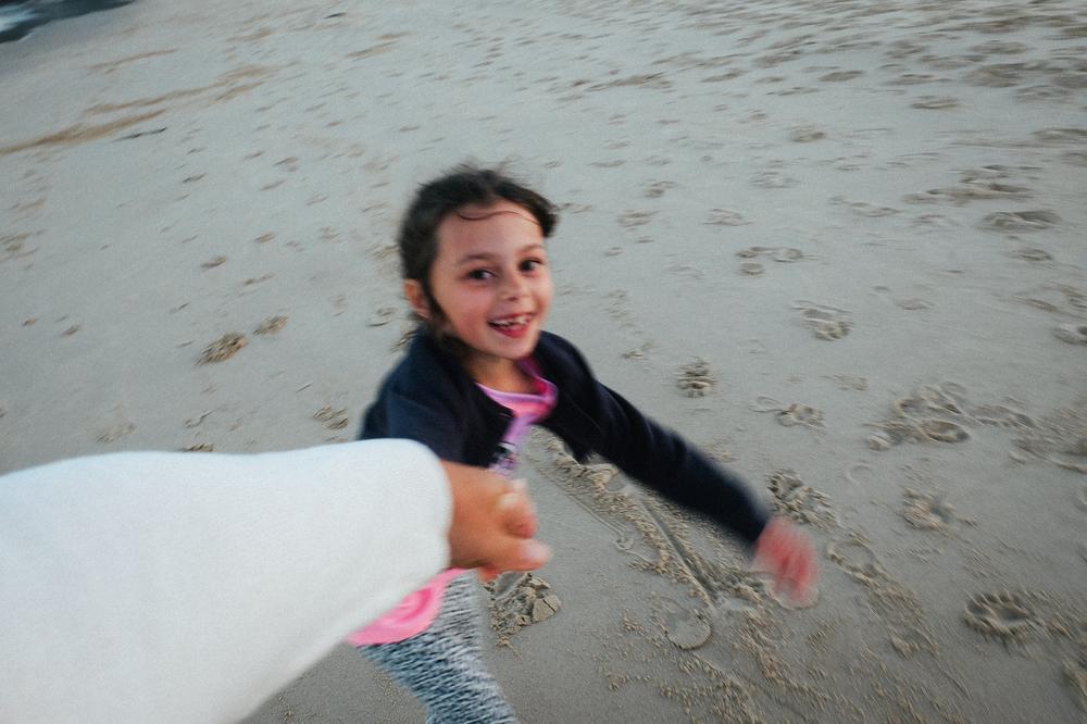 Pippa holding my hand, Pambula Beach, 2014