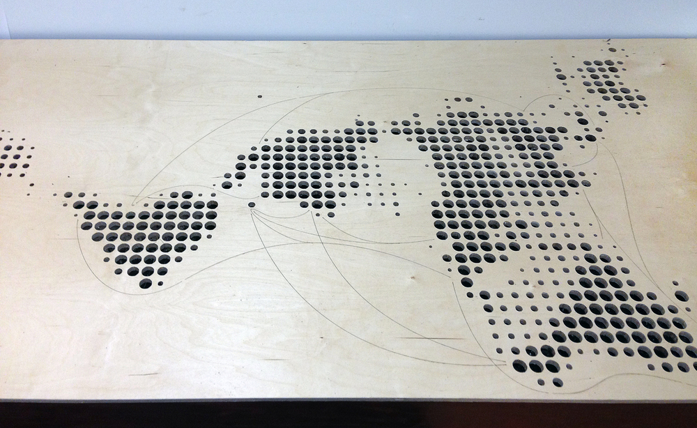 A view of the digitally routed and etched table showing continents and shipping lanes.
