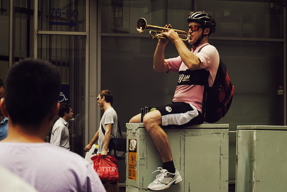 a man playing music to the pedestrians