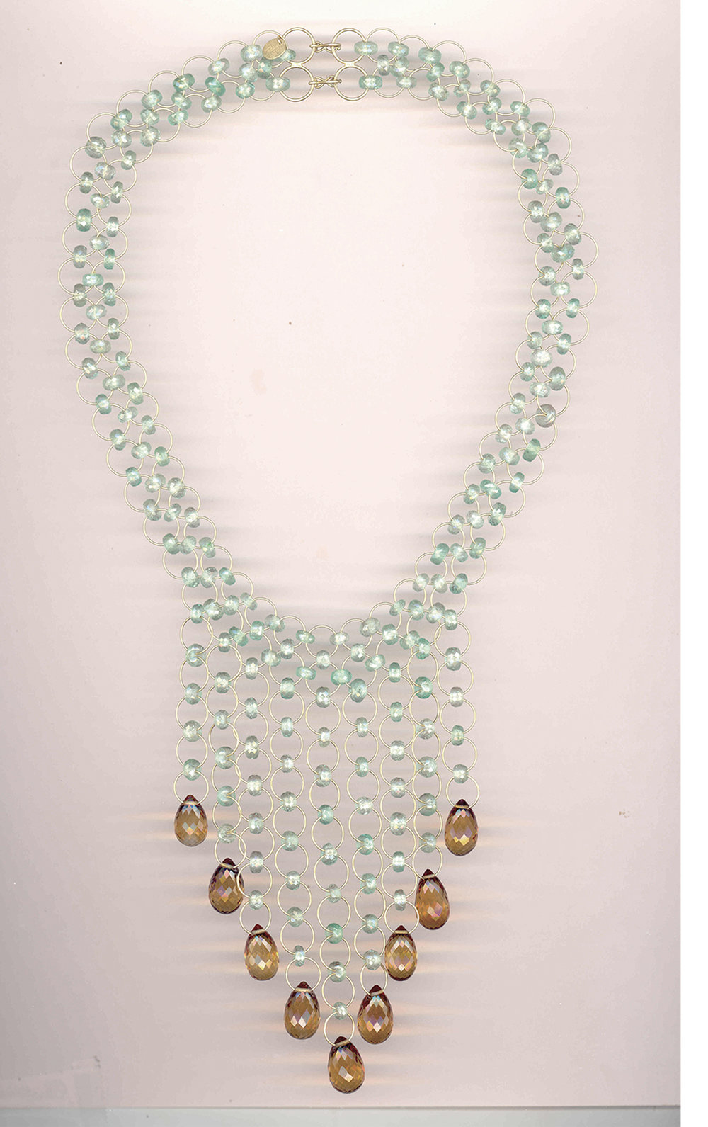 BEFORE IMAGE   Direction: Silhouette the necklace.
