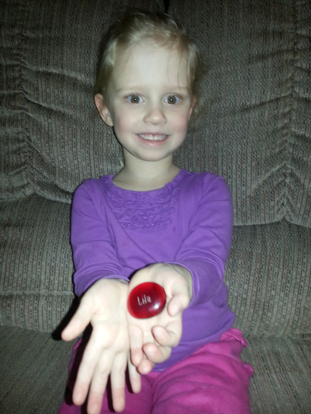 Kira proudly holding her Lila Stone
