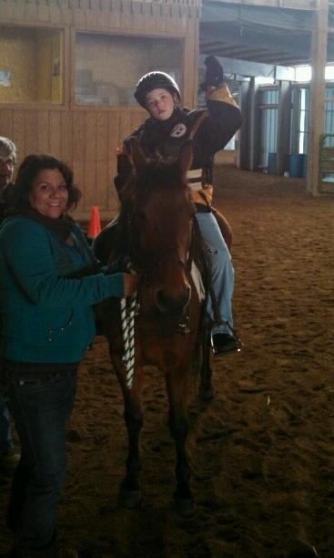 Chris holding Lila up high at TREC