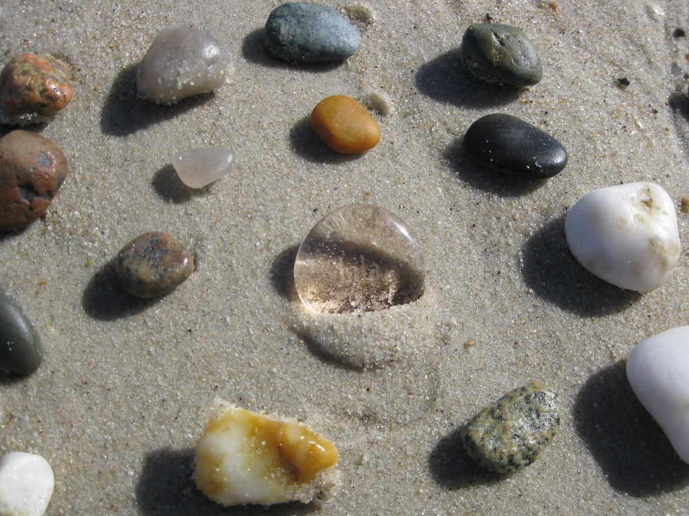 Lila stone with other stones on Cape Cod