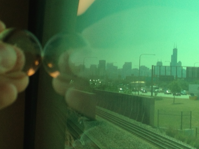Lila stone looking at the view of Chicago from the train