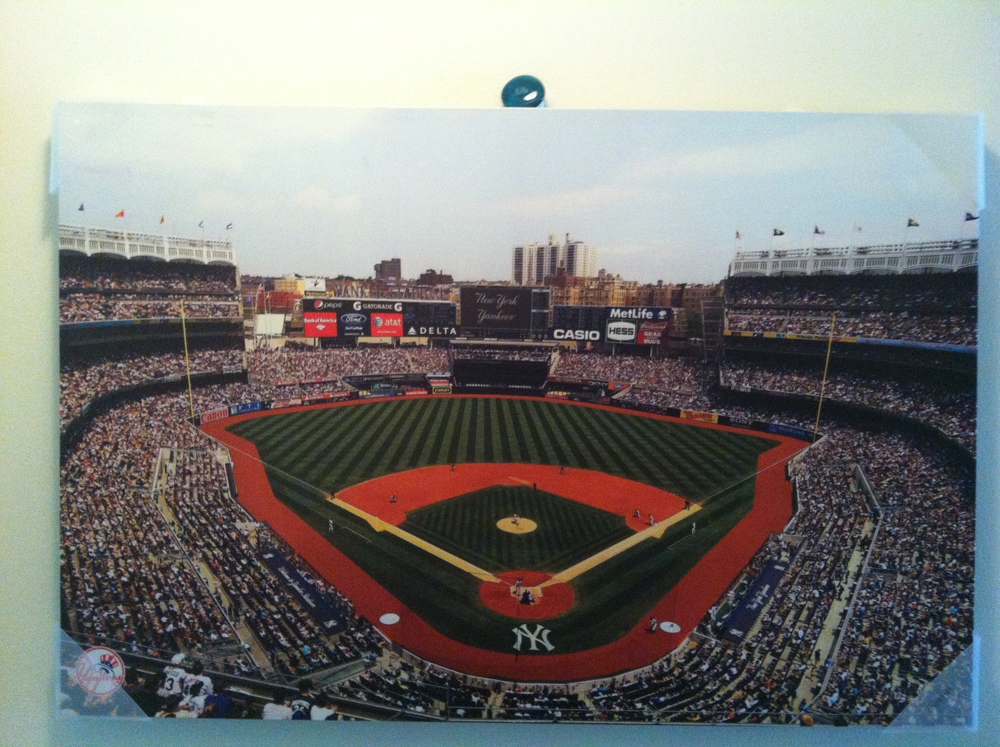Lila stone on Sarah's Yankees Picture in her new apartment