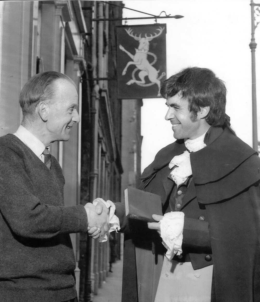 23_John Cairney as Robert Burns with Mr C. Littlejohn at the White Hart Inn 1965.jpg