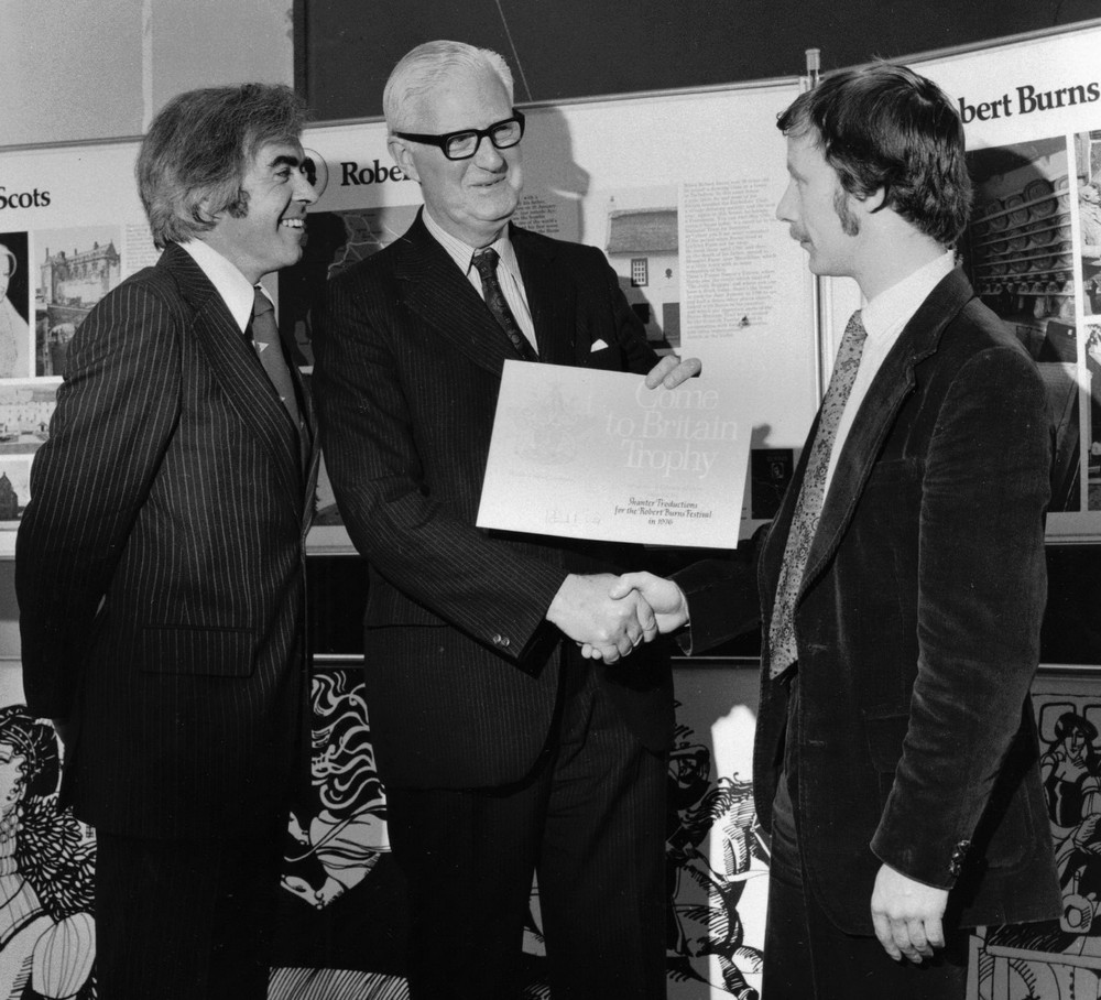 34_Robin MacLellan presents John Cairney and Colin Harvey Wright with the 'Come to Britain' award 1976.jpg