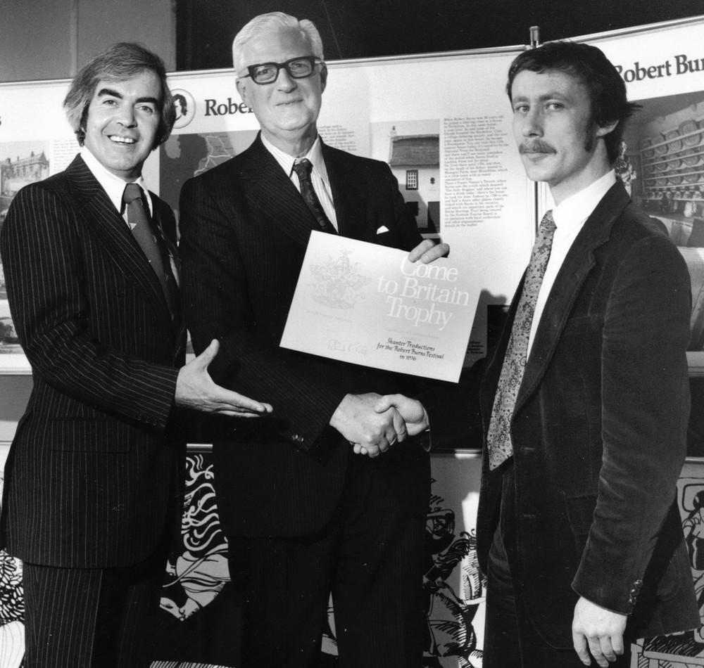 35_Robin MacLellan presents John Cairney and Colin Harvey Wright with the 'Come to Britain' award 1976.jpg