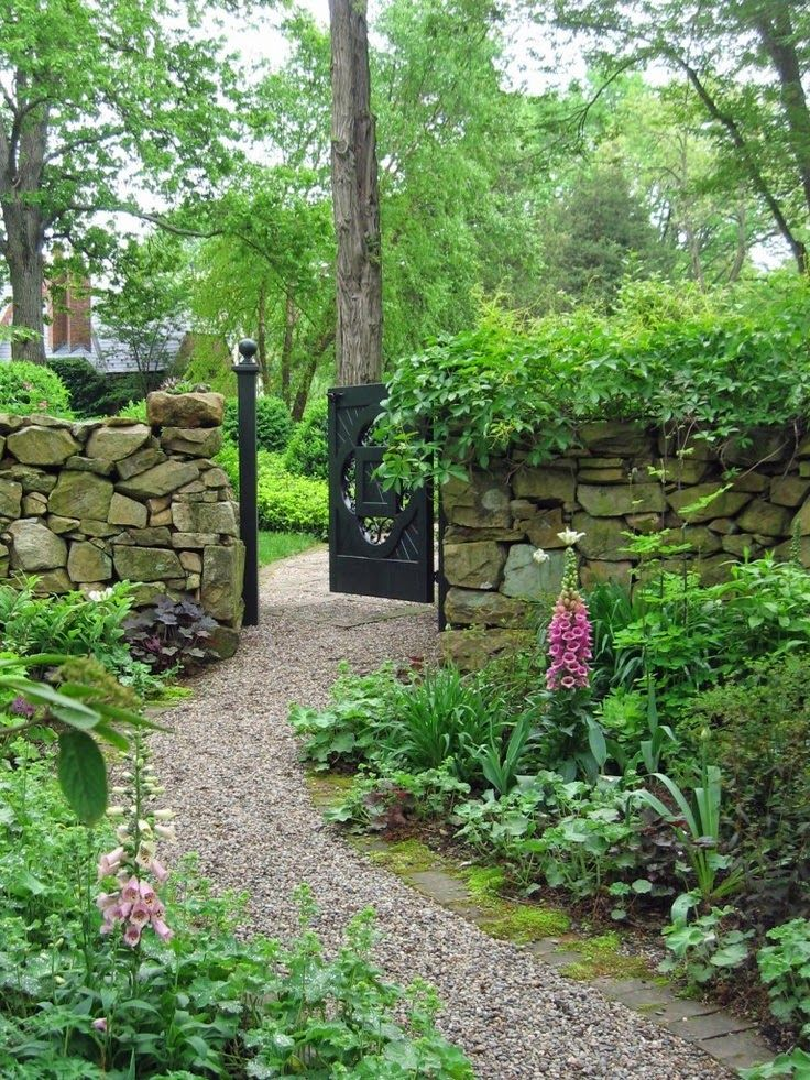 Stone walls pea gravel path. ~ Style Estate  - 15 Gorgeous Garden Gates