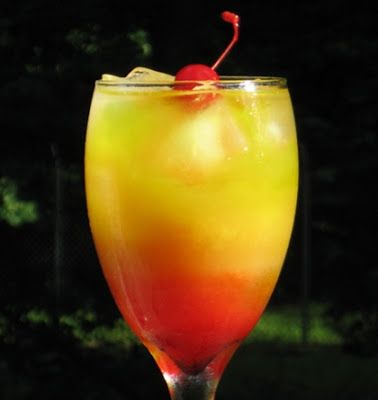 Sex on the Brain - 1 oz. Vodka, 1 oz. Midori Melon Liqueur, 1 oz. Peach Schnapps, 2 oz. Pineapple Juice, 2 oz. Orange Juice, .5 oz Grenadine, Cherry to garnish. ~ 25 Deliciously Naughty Cocktail Recipes - Style Estate -