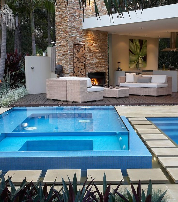 30 serene outdoor living spaces style estate for Glass swimming pool