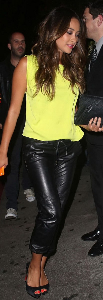 Shay Mitchell leaving Chateau Marmont wearing a bright yellow tank, cropped leather pants, a leather clutch, and peep-toe Christian Louboutin heels