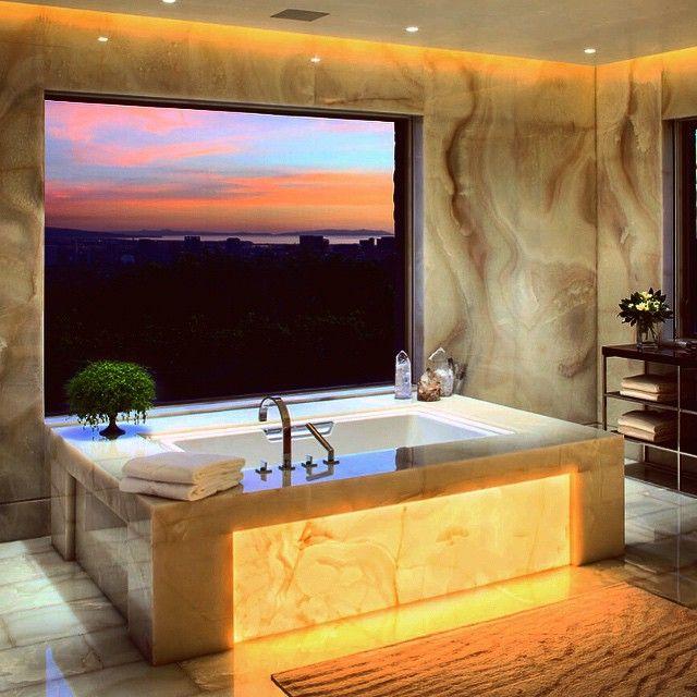 500 000 illuminated onyx bathroom with sunset views for Onyx bathroom design
