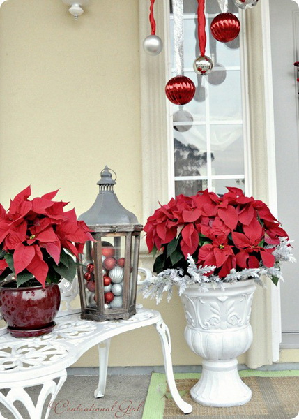 I managed to plant poinsettias and suspend a few ornaments on the front porch, but that's it.  It's simple and pretty, so I thought I'd share. And why not some thoughts on the season to go with it.  -- Porch Poinsettias Etc… by Centsational Girl