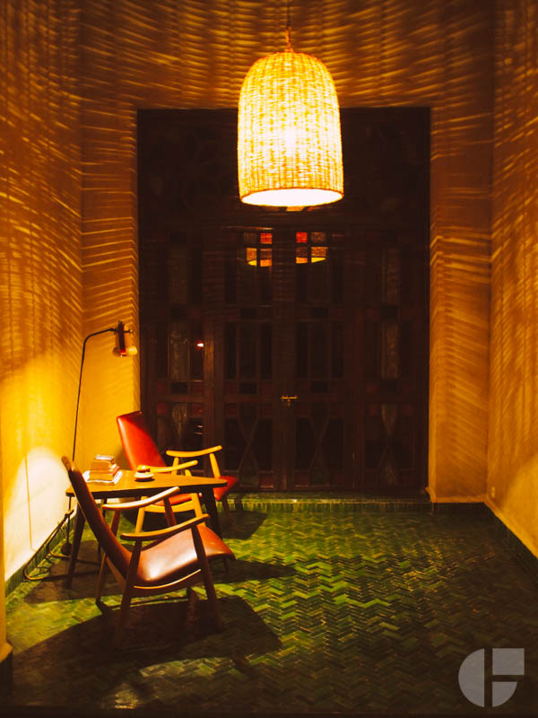 A cozy reading nook at El Fenn. In love with the herring bone tile and those shadows.