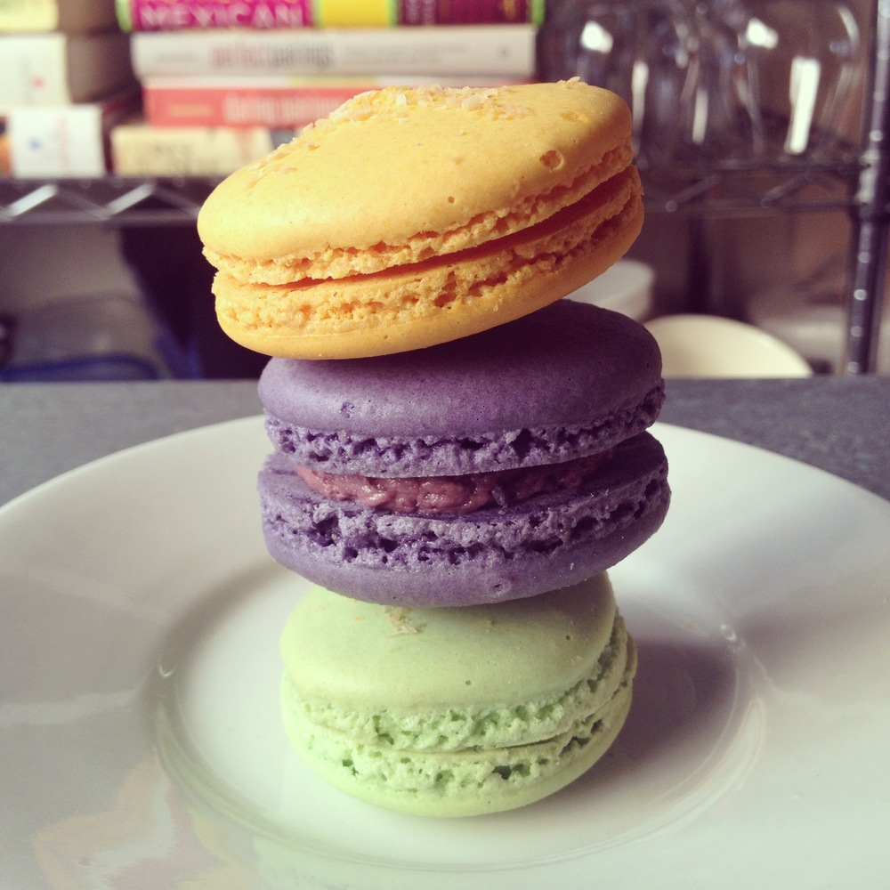 From top to bottom: durian macaron, taro macaron, and pandan macaron from Van's Bakery.