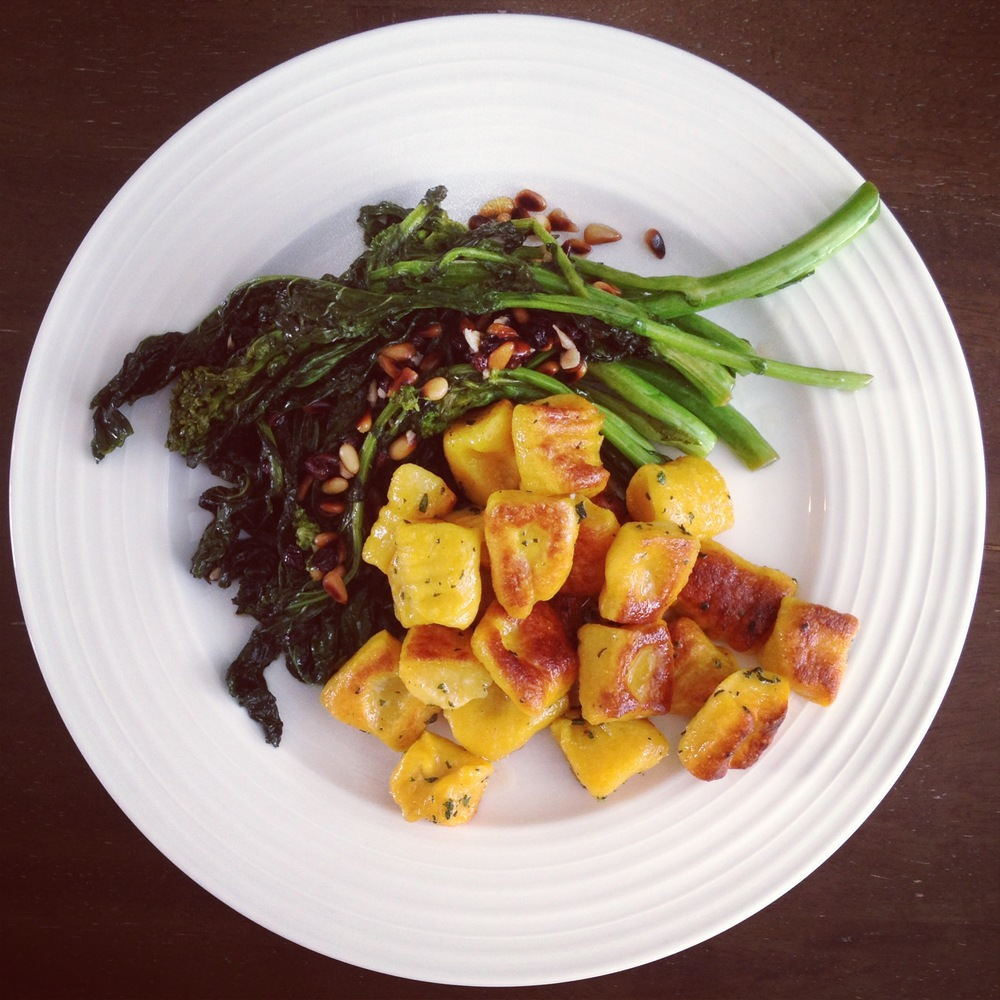 Pumpkin Ricotta Gnocchi with Brown Butter Sage and Broccoli Rabe with Currants and Pine Nuts