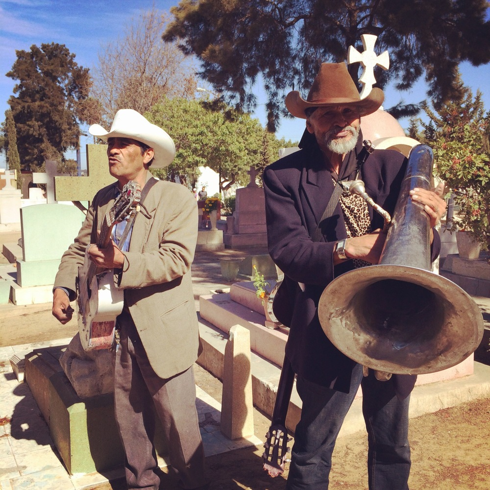 Of course there is a band rockin' out at the cemetary.