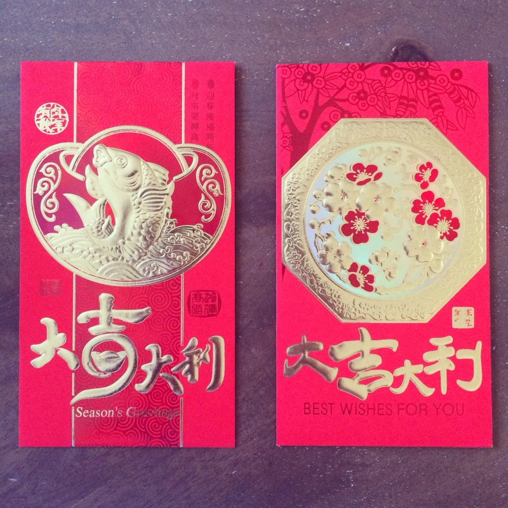 Pretty red envelopes filled with money given to us by my parents for good fortune :)