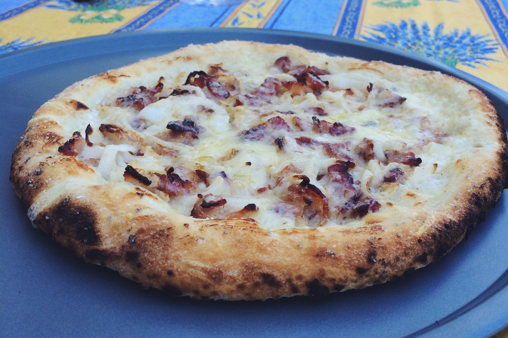 bacon, onions, and melted gruyere over a fromage blanc pizza