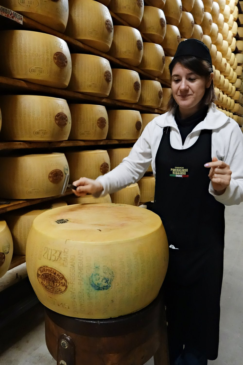 Every twelve months, the inspectors of the Consortium examine each cheese one by one. These tests are done by tapping the cheese in order to hear the sound it makes, similar to what a stethoscope does. If a cheese passes inspection to meet the requirements of the PDO, a mark is fire-branded onto the individual cheeses.   The cheese will not be DOP approved if it sounds like it has large air pockets or bubbles, in which case it cannot be called Parmigiano Reggiano; all identifying marks and dotted inscriptions are removed from the cheese.
