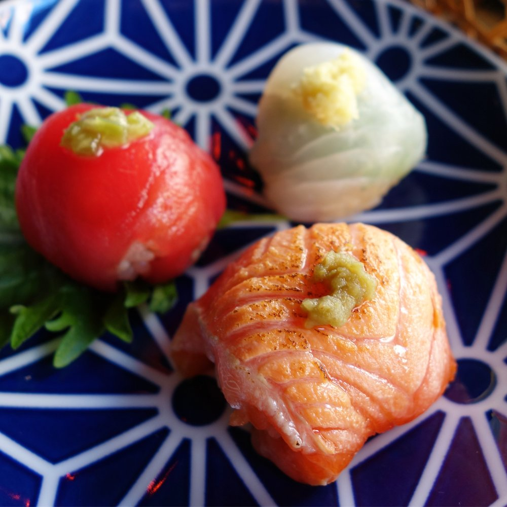 Temarizushi - ocean trout, maguro, and squid from the Megumi set.