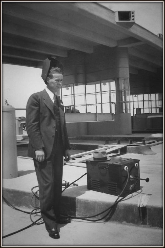 Clyde demonstrating a welding machine on the Bay Bridge in 1937