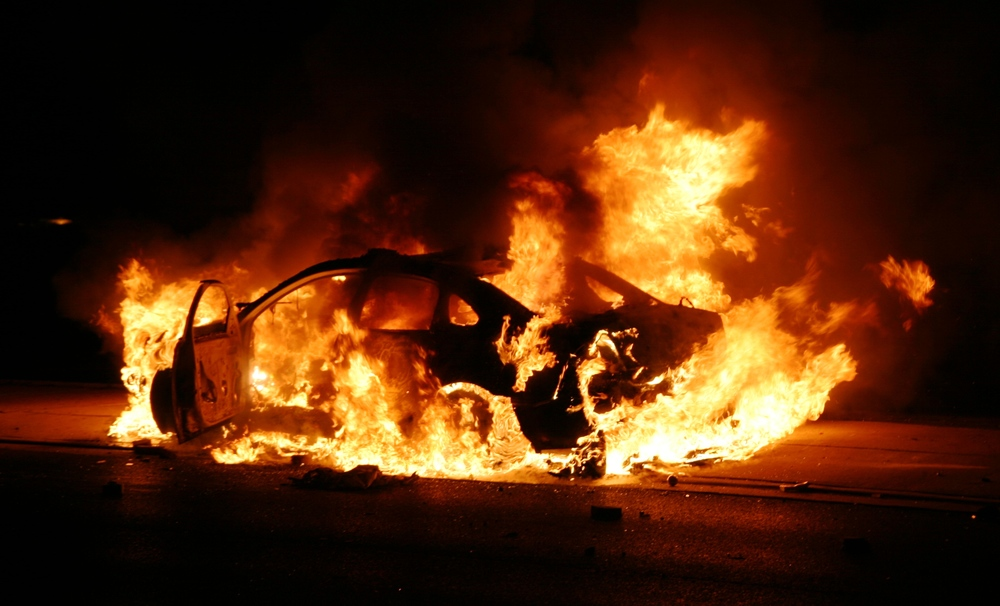 A police car burns in Ferguson, Missouri on November 24, 2014. (Photo by Nicholas Phillips)
