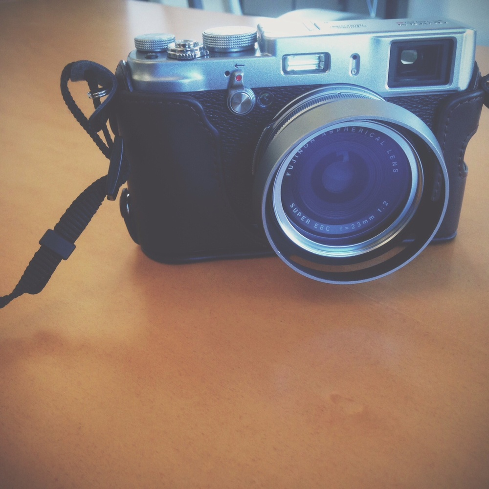 My new Fujifilm x100s with lens hood and leather case.