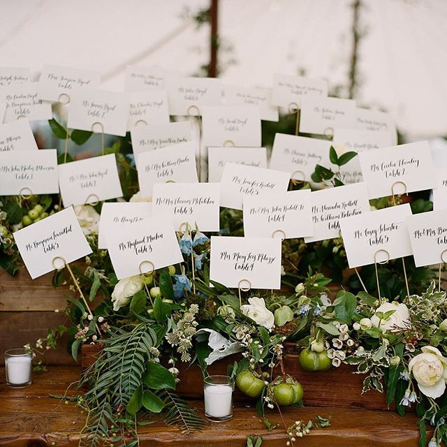 Guests found their seats with our calligraphed escort cards in a dreamy summer garden by @amyosabaevents! What a gorgeous @toast_events wedding! Photo by @abryanphoto