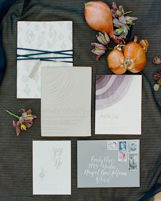 Layers of lovely making our hearts swoon over on @greenweddingshoes! Peel back each layer of the suite & you'll find that we hand dyed each layer of the onion inspired save the date, hand stamped the ceramic invitations with custom stamps for a gorgeously deep impression & wrapped the suite up with earthy illustrations on onion skin paper & a velvet ribbon! Event design @amorology, photos @featherandstonephotography, florals @runningwildflorals, tabletop rentals @hostesshaven, furniture rentals @witty_rentals, specialty rentals @backupbackdrops, produced @beinspiredpr, cake @heytherecupcake_ , wedding dress @mywony_bridal, hair stylist @thehalcyonagency, crown @melindarosedesign  #customweddingbranding #weddingbranding #weddinginvitations #invitations #invites #onion #layers #clay #ceramic #savethedates #luxuryweddinginvitations #california #californiaweddinginvitations #weddingday #married #inspired #weddingstyling #weddingseason #popofcolor #weddinginspiration #weddinginspo #calligraphy #vintagestamps #stamps #illustration