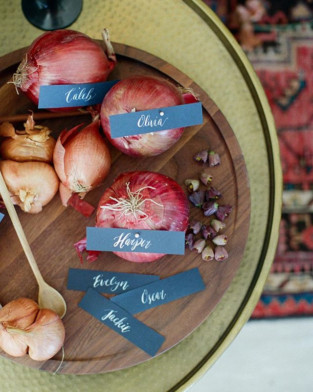Calligraphy & onions...who knew they were a match made in heaven! Leave it to @amorology to dream up this outrageous beauty inspired by none other than the humble onion! @featherandstonephotography @hostesshaven @runningwildflorals @witty_rentals @heytherecupcake_ @mywony_bridal @thehalcyonagency @beinspiredpr @backupbackdrops @melindarosedesign! See more on @greenweddingshoes  #weddingbranding #customweddingbranding #lovelypaperthings #wedding #event #luxurywedding #ceramic #debossed #calligraphy #layers #wedding #california #layers #weddinginspo  #weddinginspiration #placesetting #luxevent #florals #wed