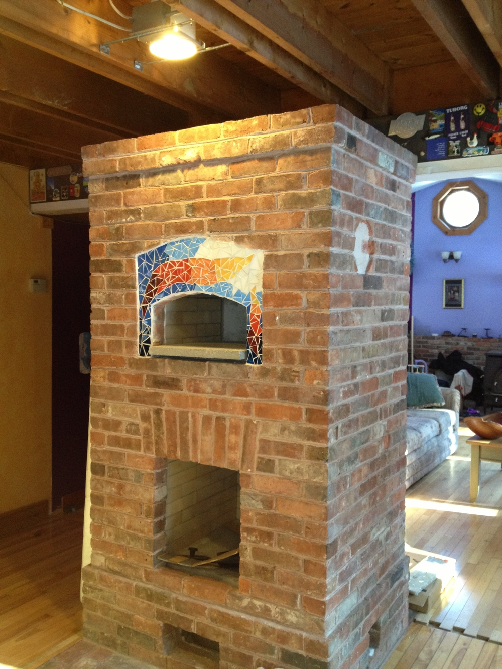 Masonry Heater with glass mosaic made by Peter Muller, which I installed.