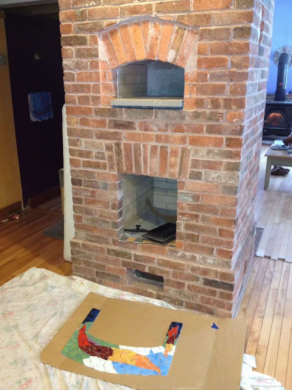 Here is an image of the heater, just before the mosaic was installed, the mosaic on the floor is face down, stuck together temporarily by contact paper.