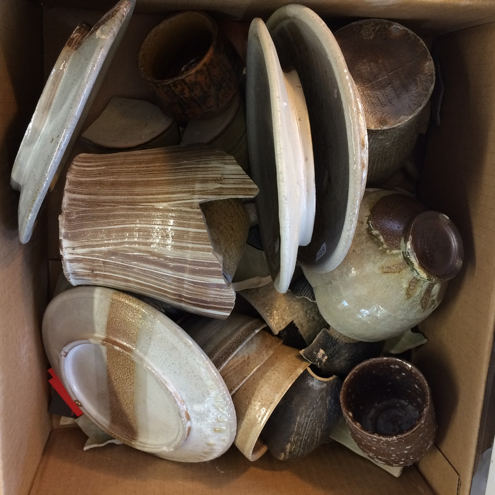 Box of Steve Theberge's pottery seconds ready to be cut up and made into pieces of trees.