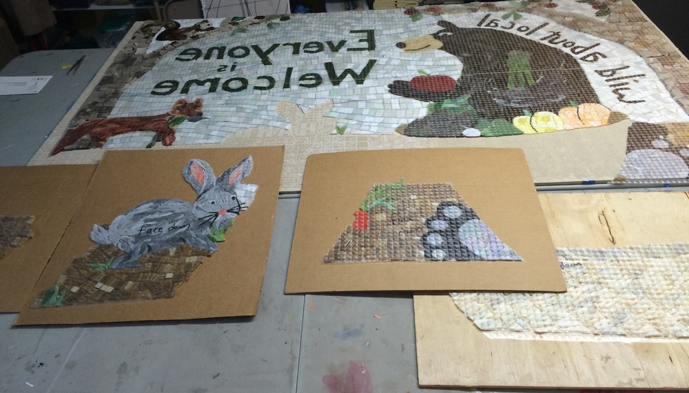The mosaic cut into sections, secured to the contact paper and flipped over.