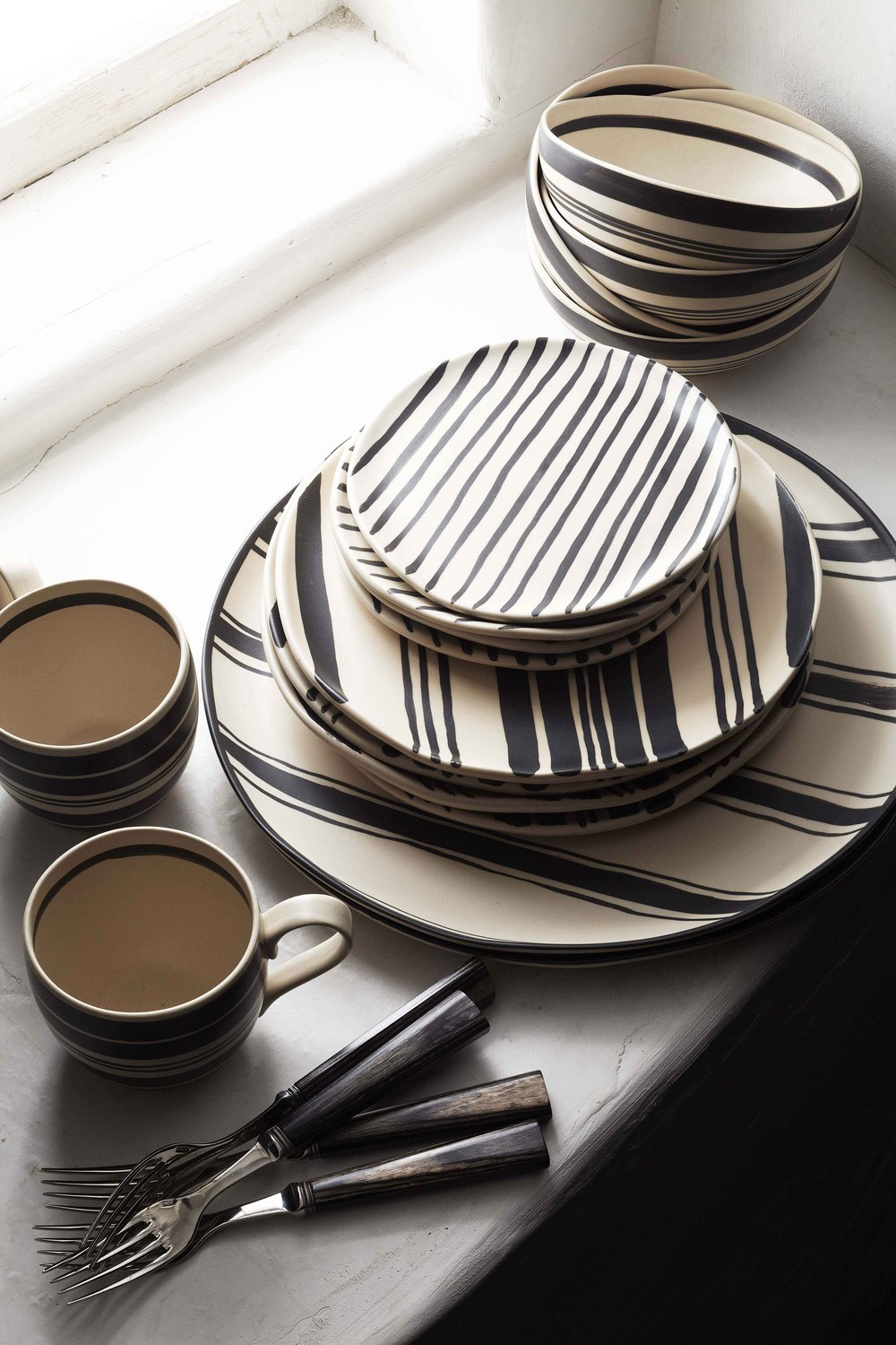 Wythe dinnerware $45-$150 and Zen flatware $295 (five-piece setting)