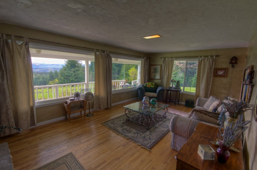 Bay windows in a living room of a house for sale in Buxton, Oregon