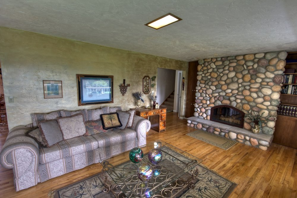 Living room with fireplace in a house for sale in Buxton, Oregon