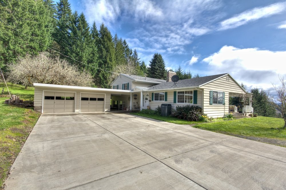 Driveway view of a house for sale in Buxton, Oregon