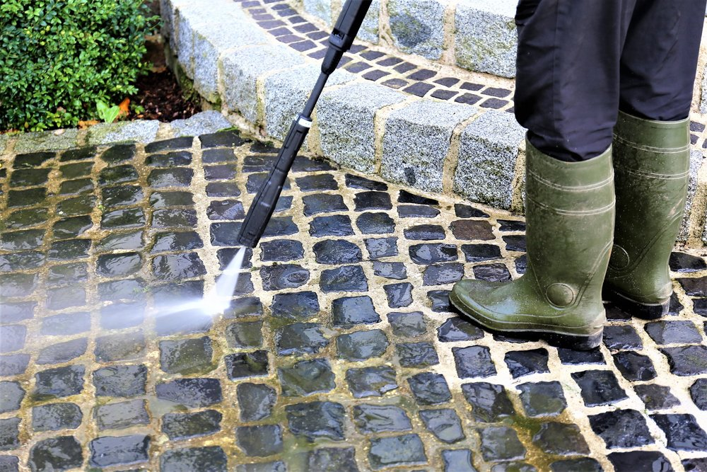 pressure washing and cleaning the house for better curb appeal