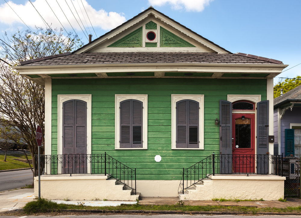 green house with faded exterior paint that has poor curb appeal