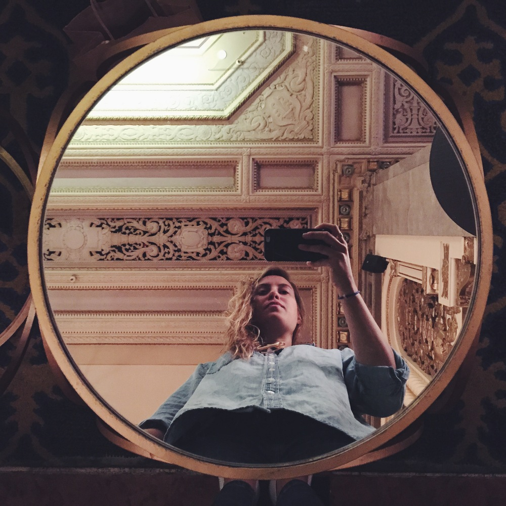 my reflection in the hotel lobby in SF